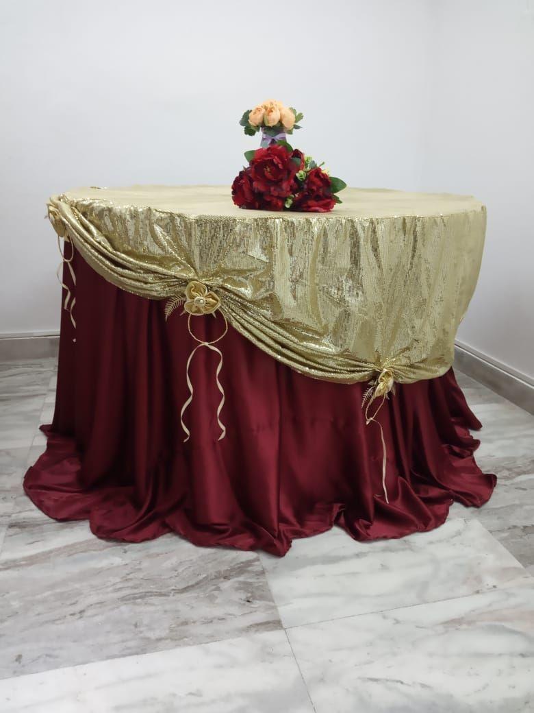 Golden sequin overlay with maroon satin underlay
