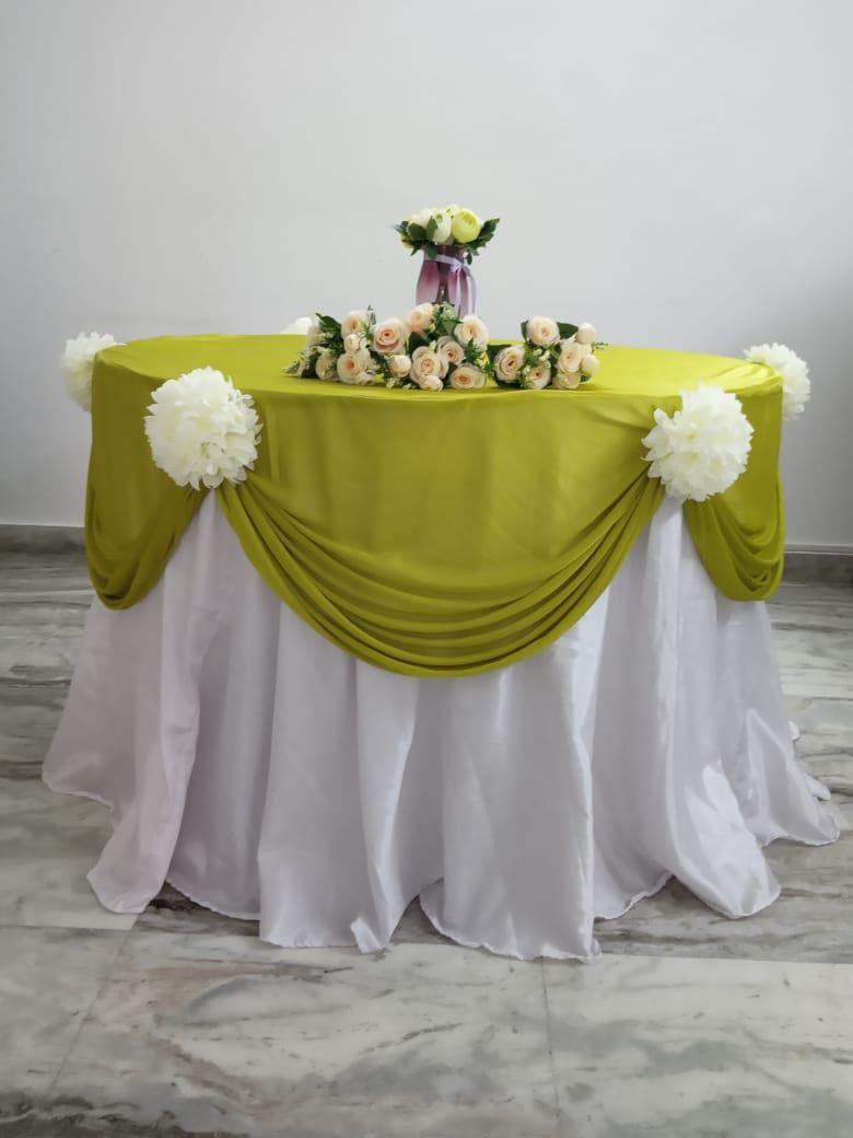 Green lycra overlay with white velvet underlay