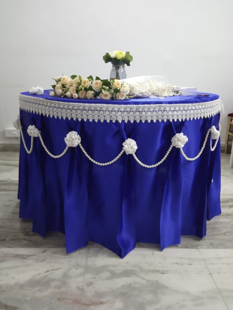 Blue satin full length overlay with white lace,pearl string and white satin flowers